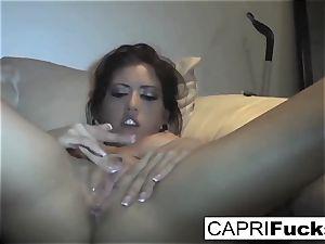 Capri Cavanni have fun with her humid vagina