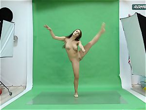 enormous orbs Nicole on the green screen stretching