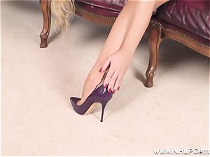 blond unwraps off lingerie and solos in nylons and high-heeled slippers