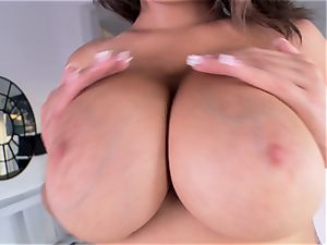 immense chested Cassidy Banks flashes her giant knockers as she milks