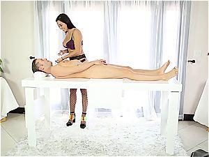 luxurious massagist tugging shy man