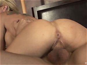 platinum-blonde cougar with phat faux jugs Sarah Jessie
