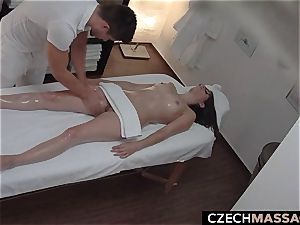 brunette with Glasses Seduced on massage Table